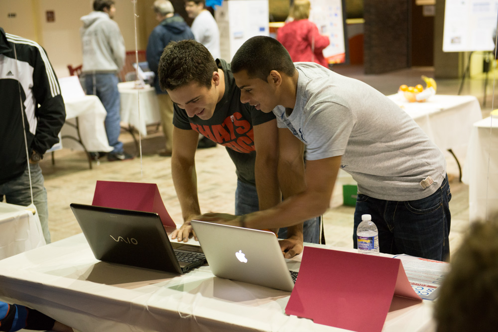 Two students at laptops